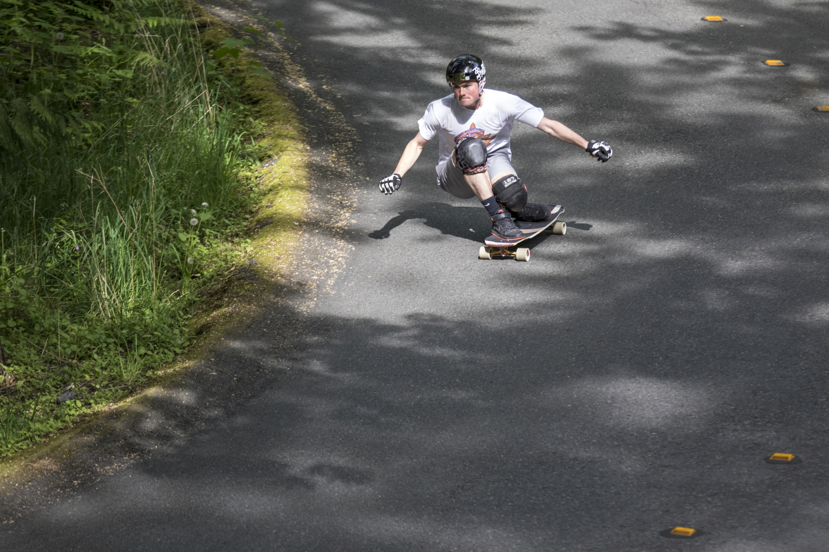 DB Longboards rider Spencer Smith longboarding through the streets of Seattle on the DB Longboards Keystone. DBLONGBBOARDS.COM