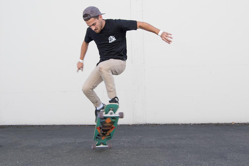 Photos of Ian Higler riding the DB Longboards Dyad V2.